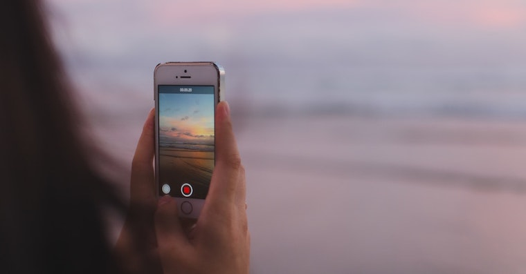 iPhone on beach fb Unsplash