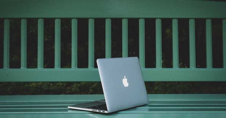 MacBook Pro on Green Bench Yusuf Evli Unsplash